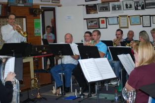 The band rehearse for a concert with Trumpet legend Allen Vizutti
